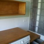 wasruimte met plaats voor vouw- en strijkwerk